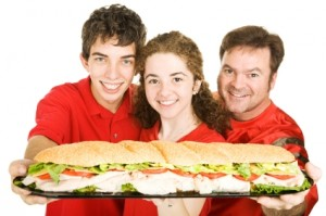 Sports Fans With Giant Sandwich