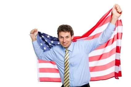 young businessman with american flag, isolated on white