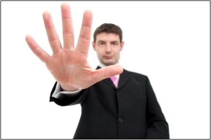 Businessman Holding Up Five Fingers