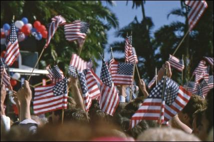 crowd waving united states flag
