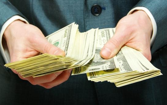 handing money