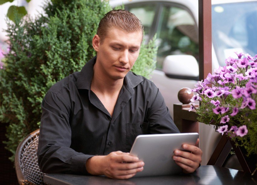 Reading small business news on tablet
