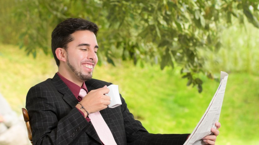 man reading small business news