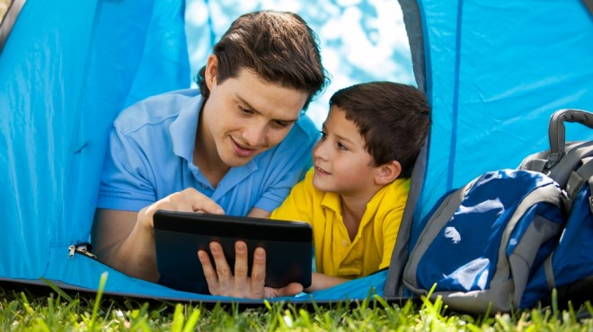 reading tablet while camping