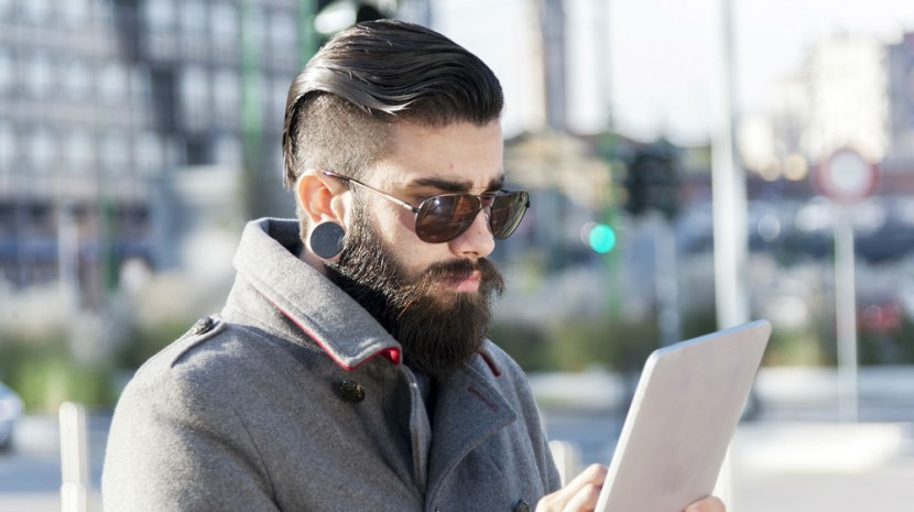 hipster on tablet