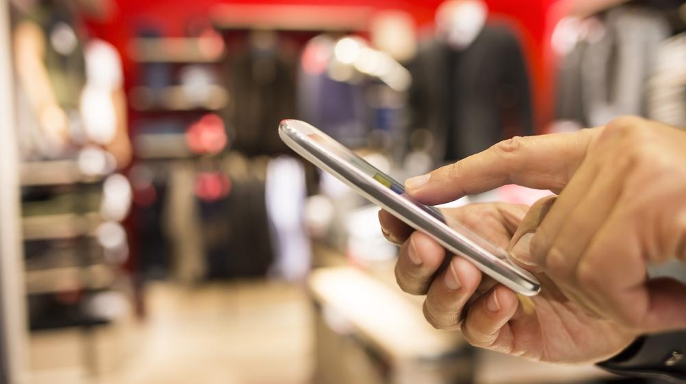 hand texting online shopping retailer txtmeQuick