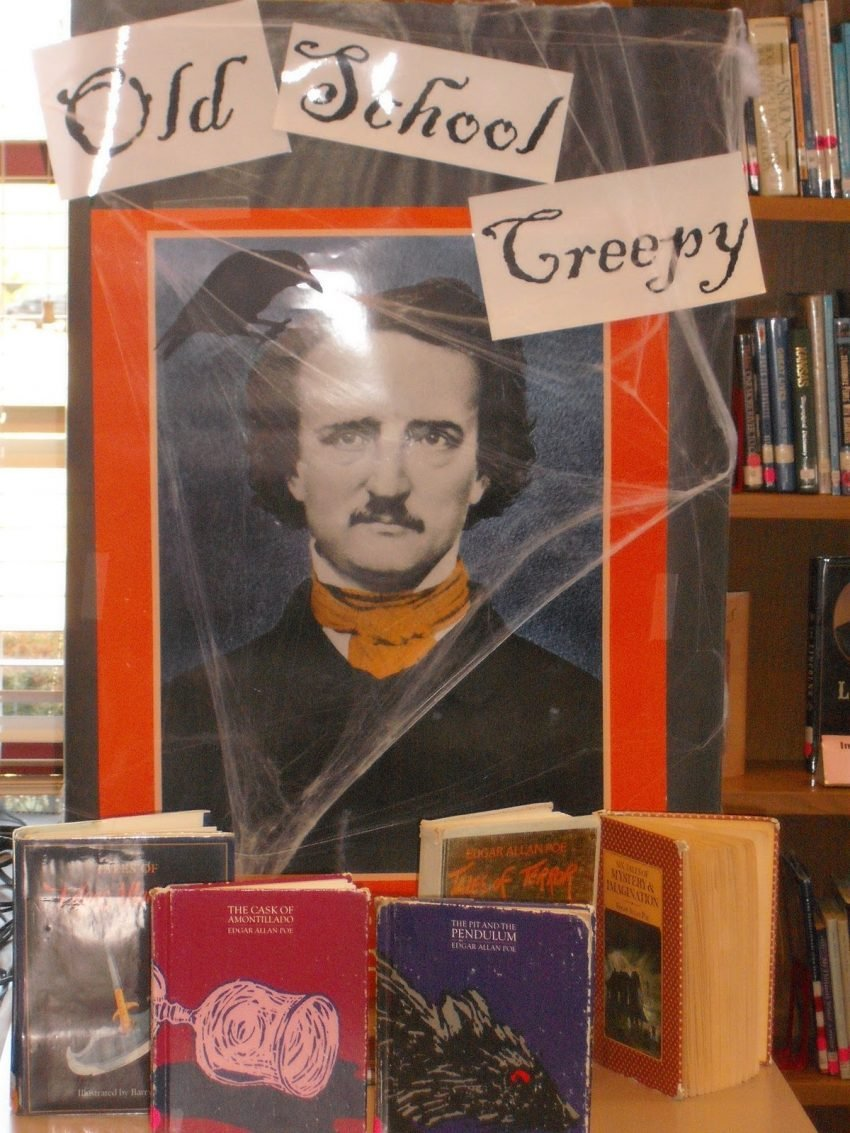 25 Examples of Halloween Retail Displays to Inspire You - Edgar Allen Poe Book Display - Halloween Retail Displays - Halloween Retail Ideas - Halloween Display Ideas